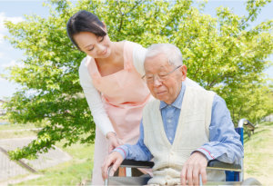 caregiver assisting senior man