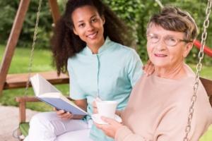 caregiver accompanying senior woman